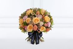 Hayford & Rhodes 2018 Mothers' Day bouquet, Motina, used coral shades alongside yellow, orange, lilac and pink. Bread And Roses, Mother's Day Bouquet, Live Coral, Winter Night, Lilac, Pink, Beach Holiday, Color Of The Year, Rhodes