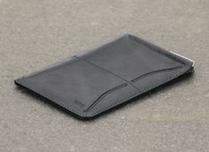 Bellroy Passport Sleeve Wallet - $99.95  Love the fact that you get a slot for the passport, two credit cards, a boarding pass sleeve, AND a micropen for filling out forms. My dad is always carrying around all that whenever he travels and having it nice and neat would make him look less cluttered. Father's Day/Birthday Present
