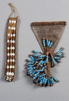 Africa | Cache sexe and a belt from the Kapsiki people from the Mount Mandara region of northern Cameroon | Cache sexe; leather, iron and glass beads.  Belt; Natural fiber, shells and glass beads