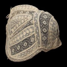 Infant's cap      French, probably 19th century       France  Dimensions      16.5 x 15.6 cm (6 1/2 x 6 1/8 in.)  Medium or Technique      Cotton mull with cotton embroidery, linen lace, and linen ties  Classification      Costumes   Accession Number      35.1144