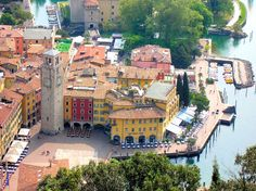 del Garda or Riva is the northernmost village on Lake Garda and well known for its beaches, resorts and water-sport adventures. Italy Architecture, Green Architecture, Comer See, Riva Del Garda, Garda Italy, Italian Lakes, Lake Garda, Visit Italy, Northern Italy