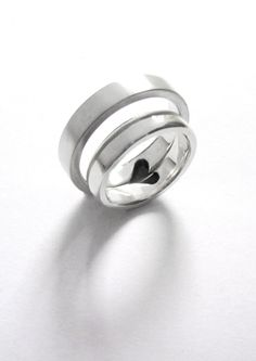 Sterling Silver Set Of Rings With Half A Heart Each