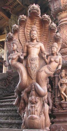 Buddha Shakyamuni protected by Nine Nagas (Subterranean Beings).