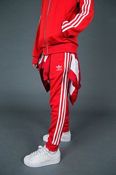 Marking the tracksuit's ongoing significance in sport, style and culture, adidas has named Friday November as and they're inviting everyone to get involved. adidas has colla… Track Suit Men, Red Adidas Tracksuit, Adidas Superstar Tracksuit, Jogging Adidas, Adidas Outfit, Sporty Outfits, Sport Fashion, Adidas Fashion, Stylish Clothes