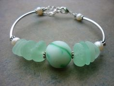 Sea glass Marble bracelet in sea foam mint green,  Hello,  Welcome !    This stunning bracelet is made from a genuine frosty sea glass marble