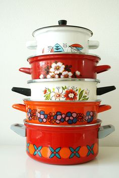 Collection of vintage enamel cooking pans.