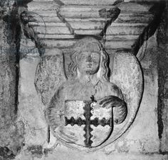 Angel bearing a shield with the engrailed cross of the St. Clair family, Rosslyn Chapel, Edinburgh, Scotland