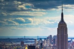 The Empire State Building towering over Manhattan Island as seen from the top of Rockerfeller Plaza.