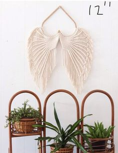 I hand make these beautiful, unique macrame angel wings in my home in Clearwater, FL. They are made with the softest all natural cotton string and hung from a birch wood heart frame. The heart frame is cut by another local small business. Each piece is Angel Wings Art, Macramé Angel, Angel Wings Wall Decor, 3d Origami, Diy Origami Blume, Origami Fashion, Art Macramé, Macrame Owl, Macrame Wall Hanging Diy