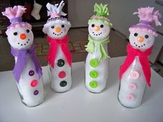 This is a pic of my completed SnowGirls made out of Starbucks Mocha bottles that have been washed  sticky label residue removed with baking soda, dawn  a tooth brush. Stuffed with stuffing, hotglued styrofoam head, button eyes/nose, fabric paint mouth, blush 4 cheeks, felt/fleece scarves hotglued, hats are old girl socks hotglued  tied w/hair ponies  cut into fringe/tassels. Added crystal beads for a little sparkle.