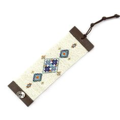 Chan Luu - Blue Mix Tribal Cuff on Brown Leather, $295.00 (http://www.chanluu.com/bracelets/blue-mix-tribal-cuff-on-brown-leather/)