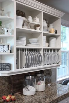 Jill Hinson of Forever Cottage transformed her kitchen by removing the cabinet doors, backing the interior with bead board and adding the plate racks to the bottom.