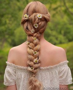 Floral Summer Braid. Perfect Hairstyle for special occasions! Created by: @aurorabraids Photo by: https://instagram.com/p/4w-kAzg4Up/?taken-by=aurorabraids #LuxyHairExtensions