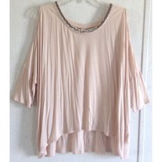 Jennifer Lopez Beaded Cold Shoulder Top Excellent condition. A few tiny pulls on the fabric that are not very noticeable. Super cute Jennifer Lopez cold shoulder top. 3/4 length sleeves with open shoulders. Sparkly beaded neckline with silver and white beads. Longer in the front than the back. The back has a cute cutout detail at the top. Beautiful light blush pink color. Soft rayon fabric. Oversized look. Size small. All offers welcome Jennifer Lopez Tops Blouses