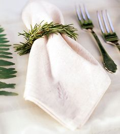 #green wedding table ... napkin / place setting