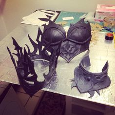 I made here a crown, breastplate and collar out of Worbla, foam and paint. In the works still unfinished.