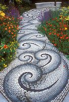 Swirling sinuous stone garden pathway | Plant & Flower Stock Photography: GardenPhotos.com