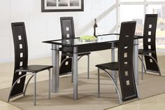 Dining TableF2212This dining room set with seating for up to four features architecture out of this world. The rectangular shape tempered glass tabletop is trimmed in a thick black line with an all black glass panel supported with wide matte finished metal legs. The seating provides an identical presence with a black faux leather seat and back adorned with square cutouts from top to bottom.F2212 Dining TableF1274 Dining ChairMaterial :GlassSilver finish metalDimensions :Table :60