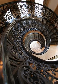 Look at how gorgeous this staircase is! I love the wrought iron railing. I have always wanted a spiral staircase in my home. We are getting a new home on May, hopefully we can incorporate something like this. Wrought Iron Staircase, Grand Staircase, Staircase Design, Modern Staircase, Stair Banister, Iron Railings, Banisters, Beautiful Architecture, Architecture Details