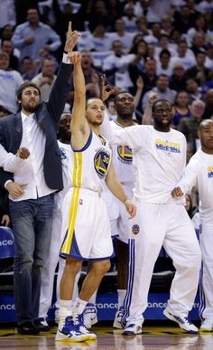 383241529 The Warriors bench waits in anticipation as Stephen Curry puts up a three.  (PS