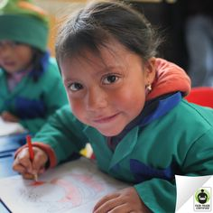 Little Shirley is all smiles while drawing in a daycare supported by #FairTrade funds. When you choose Fair Trade Certified #flowers, you're supporting flower farm workers investing in their community!
