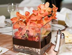 coral orchid centerpiece- would be perfect in a slightly taller vase with water and a betta fish!