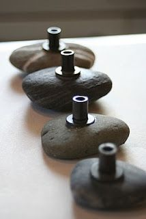"""Make your own drawer knobs. Those pieces glued to the stones seem to be called """"well nuts."""""""