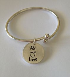Hey Guys ! Women love this kind of personalized gift! What could be more romantic than your actual hand written message of love, that she can look at daily, and be reminded of your devotion.  Double sided. www.surfingsilver.etsy.com