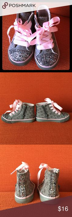 Cutie Patooties Very cute and glammed converse style sneakers for your little Princess. These cuties are in excellent used condition, no stains or loose threads, and bottom soles aren't worn at all. Side zip for easy on and off and functioning ribbon lace-up to further adjust for comfort and security. I will clean the bottom soles before shipping so they will look practically brand new when you receive them! I accept ALL reasonable offers. Maggie & Zoe Shoes Sneakers