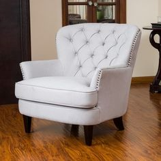No tufting, like oversized club chai look. Want skirted and more stuffing. Like the way chair arms roll outward