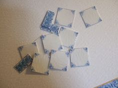 """Tutorial for how to glaze dollhouse-sized """"tiles"""" that are made from printed cardboard"""