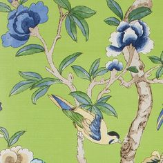 Giselle Upholstery Fabric This beautiful printed fabric features a variety of tropical birds and butterflies amongst floral branches, shown in blue on a lime green ground.