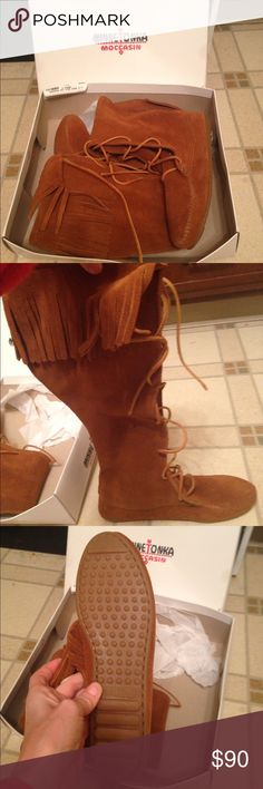 Brand-new Minnetonka moccasin boots Brand-new knee-high Minnetonka boots with fringe around the knee comes with box smoke free pet free home Minnetonka Shoes Lace Up Boots