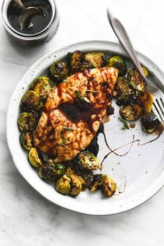 Easy and healthy sheet pan honey balsamic chicken & brussels sprouts dinner is ready in 30 minutes with a finger-licking good sweet and tangy glaze.