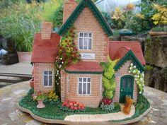 This is a gingerbread house.  can you believe it?  Summer cottage gingerbread house By toskanaloewe on CakeCentral.com