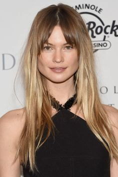 """We don't see fringes parted in the middle very often, but [link url=""""http://www.glamourmagazine.co.uk/person/behati-prinsloo/""""]Behati Prinsloo[/link] showed us how it's done - [i]flawlessly[/i] done."""