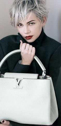 Louis Vitton. I would love this bag in any color.