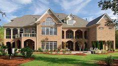 Magnificent veranda in back of Architectural Designs House Plan 50622TR.