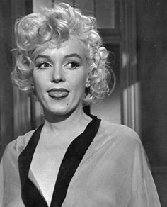 Marilyn Monroe doing that adorable little tongue habit on set of Some Like It Hot. It was a nervous habit for her, but it may also have been to ensure there was no lipstick on her teeth and/or wetting her lips to make them appear more beautiful.
