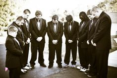 my husband praying with his groomsmen before we started!