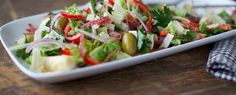 Crisping salami in the oven is a great trick and takes only minutes. Here, they add a savory crunch to a vibrant antipasto salad—think of them as salami croutons!