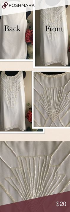 "Forever 21 Beaded Sheer Top Tunic Forever 21 Beaded Sheer Top/ Tunic. Detailed Pearl Beaded design at the front. Material: 💯 % polyester shell and lining. Color, Cream/Off white. Size: Large. Pit-pit: 20.5"", Length: 33.5"". Gently preowned. Excellent condition. If this condition is not right for you do not purchase. Forever 21 Tops Blouses"