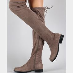 """Bamboo over the knee flat boots Over the knee boots made out of soft vegan suede. They have a low flat heel, round toe and a drawstring collar that ties at the back of the leg for a custom fit. Also has a side zipper for an easier way to put on and off.  Heel height: 1"""" Shaft Length: 21.75"""" including heel. Bamboo Shoes Over the Knee Boots"""