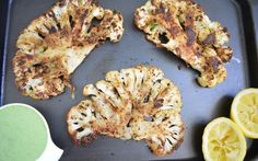 In this recipe, whole cauliflower steaks are rubbed with a special spice blend before being roasted in the oven until tender and juicy. It's then paired with creamy spinach tahini sauce that complements the heat of the spices.