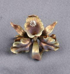 Art Nouveau 14kt Gold, Enamel, and Diamond Brooch, Krementz & Co., designed as a polychrome enamel flower with a diamond melee highlight, lg. 1 1/4 in., maker's mark.