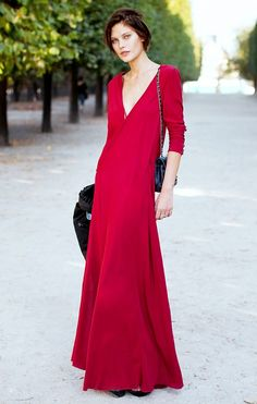 Catherine McNeil went for a dramatic street style look by wearing a floor-length red dress with black accessories // #StreetStyle