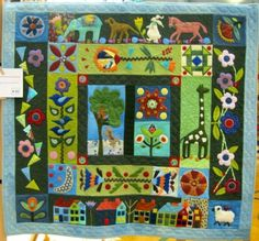 Folk Art Applique quilt by Charlene Dakin, photo by Maverick Quilts
