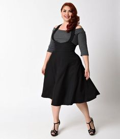 Maria will have you singing from your heart, darling! A frolicsome addition to any retro lovers wardrobe, the Plus Size Maria Suspender Skirt is an adorable piece thats causing quite the sensation! Crafted in a lightweight fabric blend, this retro black