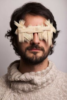 """Italian photographer Giacomo Favilla explores our role in pollution & the creation of waste in """"Anonymous"""", a series of photographic portraits. The images poignantly portray how people choose to be blind to the damage being done to the environment. The subjects of the photos are shown wearing sunglasses assembled from objects usually thrown away without a second thought. Favilla collaborated with designer Rossella Bessi to create the sunglasses…"""