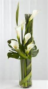 #tallcenterpiece #white #green #modern #lobbyarranagment #lilies